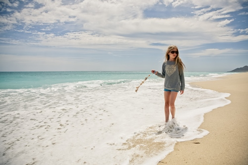 Girl with Shell Strand in Ocean