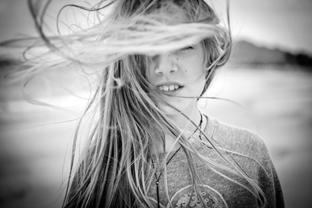 Wind blown hair by Tracey Clark shot with Canon 50mm Compact Macro Lens