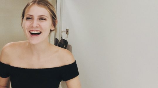 Teenage girl laughing